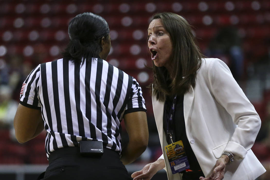 UNLV head coach Kathy Olivier questions a referee during a Mountain West Conference basketball tournament game against Fresno State at the Thomas & Mack Center in Las Vegas on Wednesday, March ...