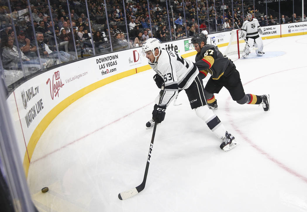 Los Angeles Kings' Kevin Gravel (53) and Golden Knights' Teemu Pulkkinen (67) go after the puck during an NHL preseason hockey game at T-Mobile Arena in Las Vegas on Tuesday, Sept. 26, 2017. The K ...