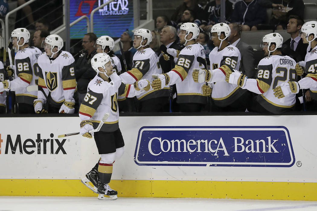 Vegas Golden Knights' Teemu Pulkkinen (67) is congratulated by teammates after scoring a goal against the San Jose Sharks during the third period of a preseason NHL hockey game, Thursday, Sept. 21 ...