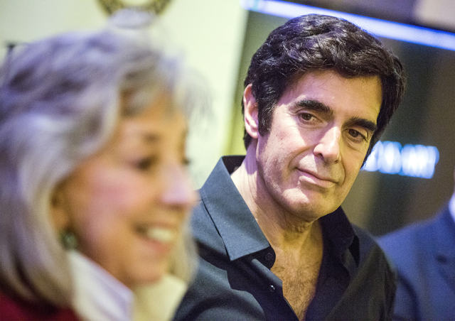 Magician David Copperfield listens while Rep. Dina Titus, D-Nev., discusses HR 642, a measure that would distinguish magic as an art form, during a news conference at The Orleans on Tuesday, Aug.  ...