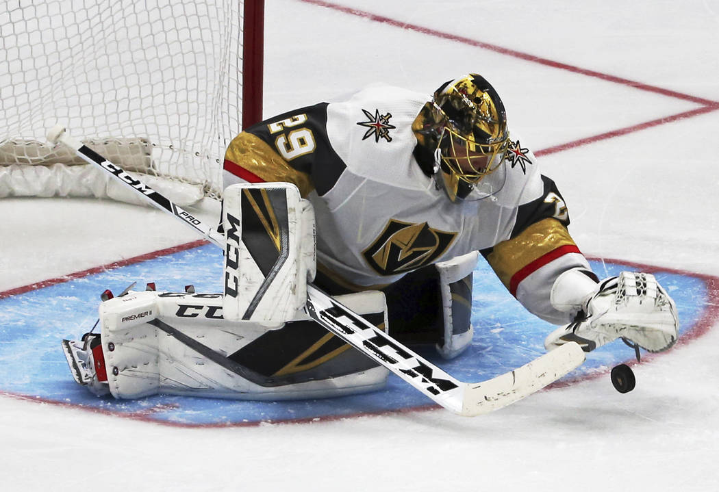 Vegas Golden Knights goalie Marc-Andre Fleury (29) stops a shot on goal by the Anaheim Ducks in the second period of an NHL preseason hockey game in Anaheim, Calif., Sunday, Sept. 24, 2017. The Go ...