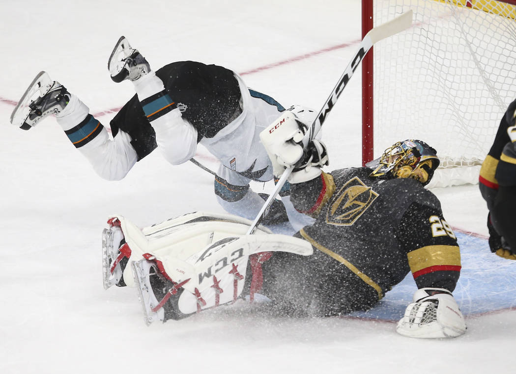 San Jose Sharks' Marcus Sorensen (20) gets tripped up while scoring against Golden Knights' goalie Marc-Andre Fleury (29) during the first period of an NHL preseason hockey game at T-Mobile Arena  ...