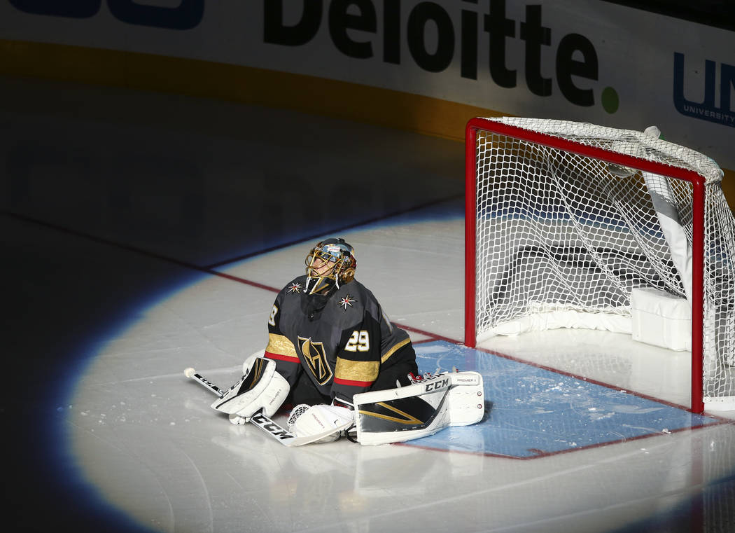 Golden Knights' goalie Marc-Andre Fleury (29) stretches before the start of an NHL preseason hockey game against the San Jose Sharks at T-Mobile Arena in Las Vegas on Sunday, Oct. 1, 2017. Chase S ...