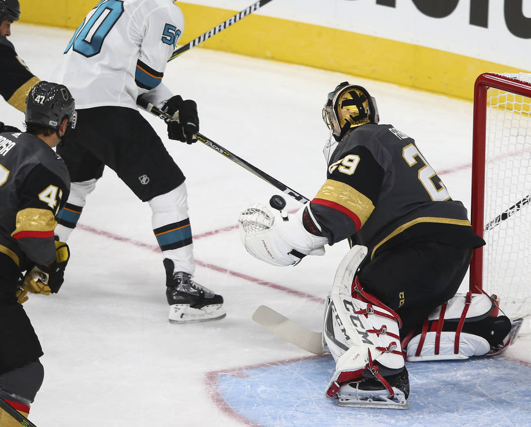 Golden Knights' goalie Marc-Andre Fleury (29) defends as the San Jose Sharks attempt to score during the first period of an NHL preseason hockey game at T-Mobile Arena in Las Vegas on Sunday, Oct. ...