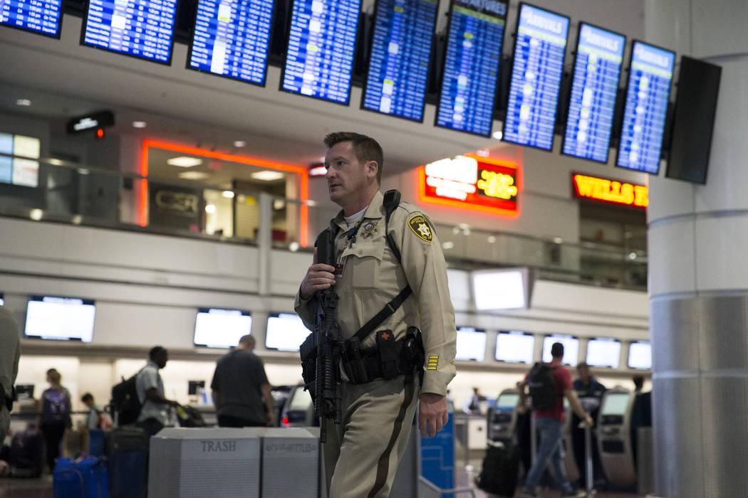 A Las Vegas police officer patrols Terminal 1 at McCarran International Airport in Las Vegas, Monday, Oct. 2, 2017. Erik Verduzco/Las Vegas Review-Journal