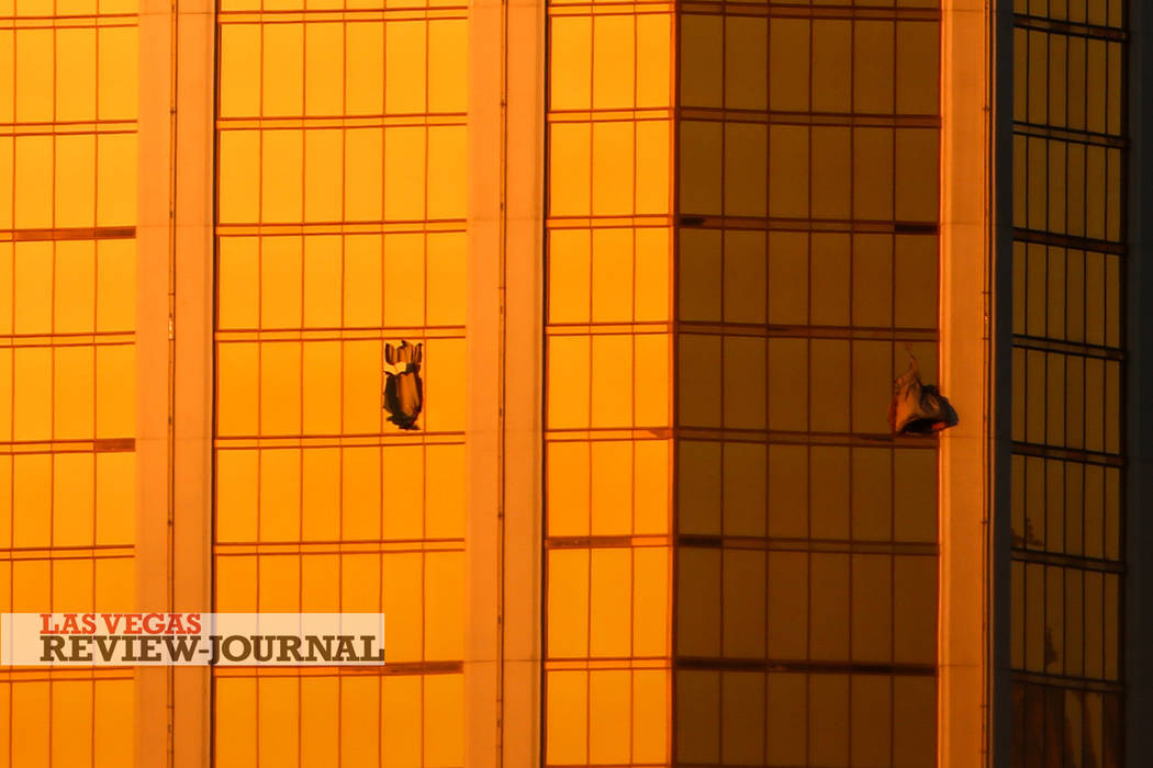 Windows from Mandalay Bay are broken after a shooting occurred leaving at least 59 dead and 500 injured in Las Vegas, Monday, Oct. 2, 2017. Joel Angel Juarez Las Vegas Review-Journal @jajuarezphoto