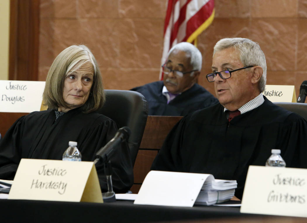 Chief Justice, James Hardesty, right, comments as Chief Justice, Kristina Pickering, looks on, during oral arguments in the legal battle over marijuana distribution at Thomas and Mack Moot Court o ...