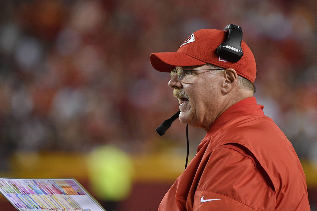 Kansas City Chiefs head coach Andy Reid talks to a player during the second half of an NFL football game against the Washington Redskins in Kansas City, Mo., Monday, Oct. 2, 2017. (AP Photo/Ed Zurga)
