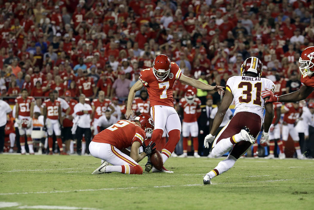 Kansas City Chiefs wide receiver Marcus Kemp (7) kicks a field goal with punter Dustin Colquitt (2) holding, during the second half of an NFL football game against the Washington Redskins in Kansa ...