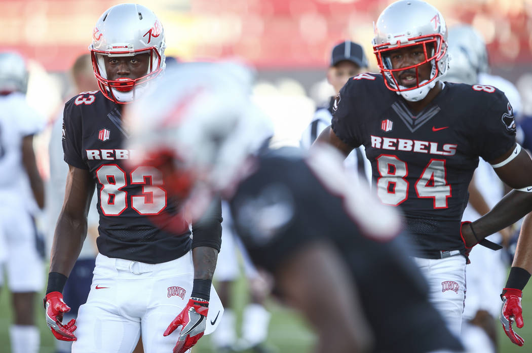 UNLV wide receivers Devonte Boyd (83) and Kendal Keys (84) warm up before playing Howard in a football game at Sam Boyd Stadium in Las Vegas on Saturday, Sept. 2, 2017. Chase Stevens Las Vegas Rev ...