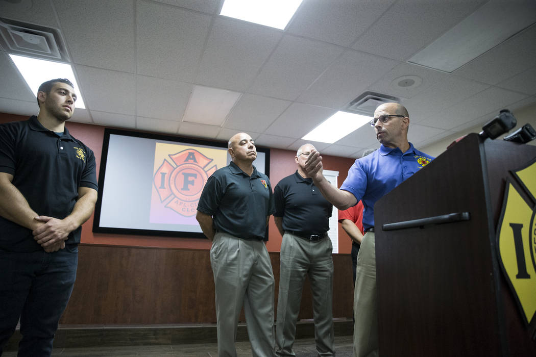 Eric Littmann, right, president of the Las Vegas Firefighters Local 1285, speaks about Henderson Firefighter Anthony Robone, left, during a press conference on the mass shooting on Sunday night, a ...