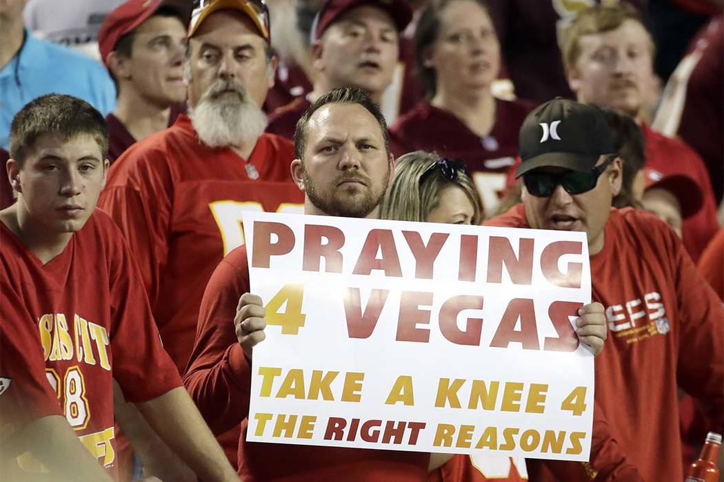 A fan holds a sign before Monday night's game between the Kansas City Chiefs and the Washington Redskins in Kansas City, Missouri, Monday, Oct. 2, 2017. (Charlie Riedel/AP)