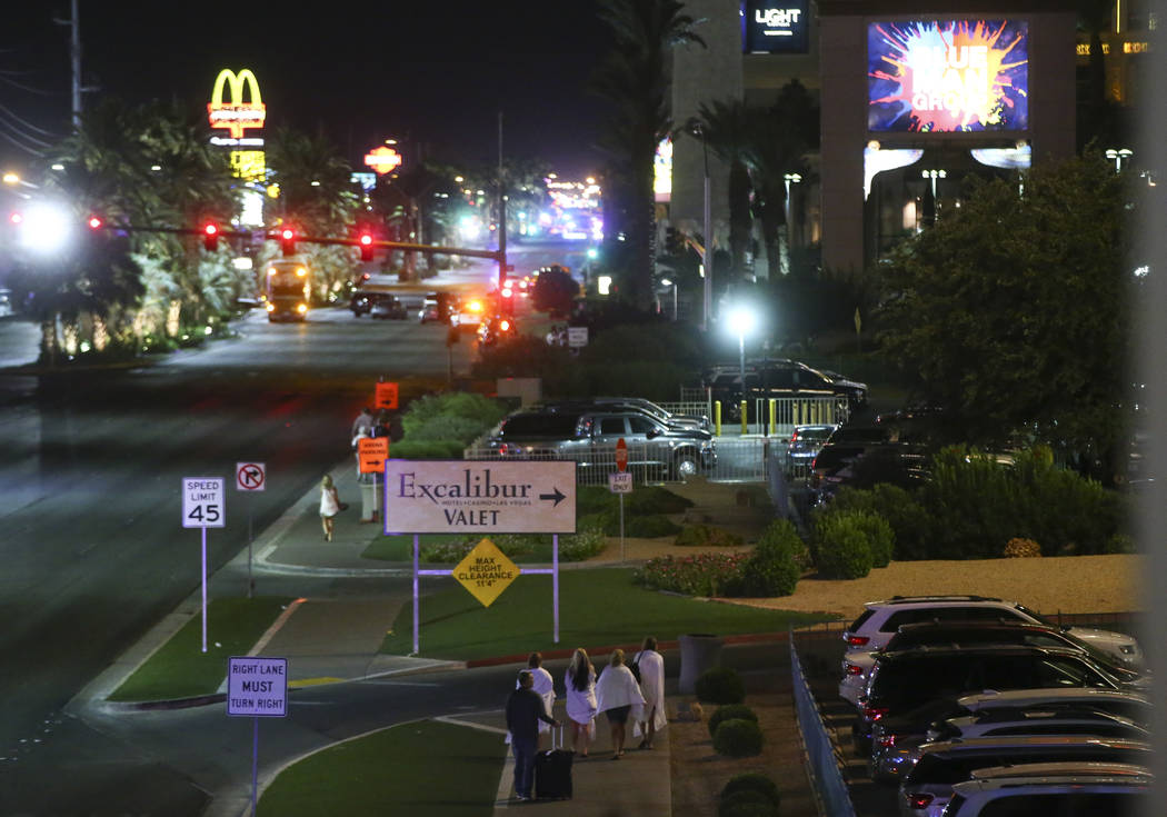 Tourists make their way back to their hotels during the early hours of Monday, Oct. 2, 2017, following an active shooter situation that left 59 dead and over 500 injured Sunday night on the Las Ve ...