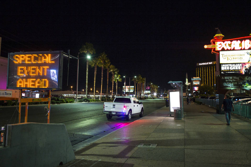 A view looking down Las Vegas Boulevard during the early hours of Monday, Oct. 2, 2017, following an active shooter situation that left 59 dead and over 500 injured Sunday night on the Las Vegas S ...