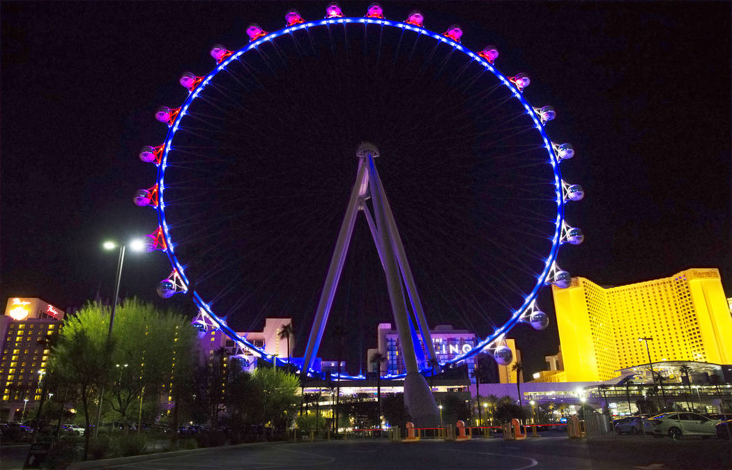 The High Roller is lit in red, white and blue in solidarity and support of the shooting victims of the Route 91 country music festival  on Monday, October 2, 2017, outside The Linq hotel/casino, i ...