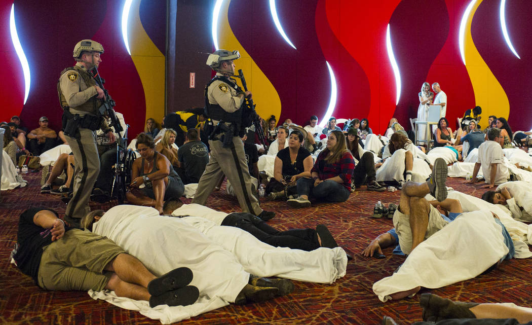 Las Vegas police patrol in a convention center area during lockdown at the Tropicana Las Vegas following an active shooter situation that left 50 dead and over 200 injured on the Las Vegas Strip d ...