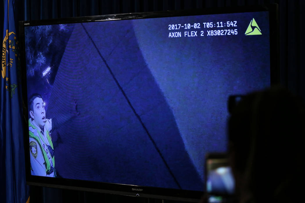 Body camera footage from Sunday night's mass shooting is presented during a press conference at the Las Vegas Police Department headquarters in Las Vegas, Tuesday, Oct. 3, 2017. Joel Angel Juarez  ...