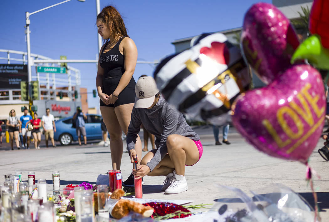Las Vegas residents Jatziry Yanez, left, and Ana Carbajal at a memorial at Las Vegas Boulevard and Sahara Avenue in Las Vegas during the early hours of Tuesday, Oct. 3, 2017. A gunman opened fire  ...