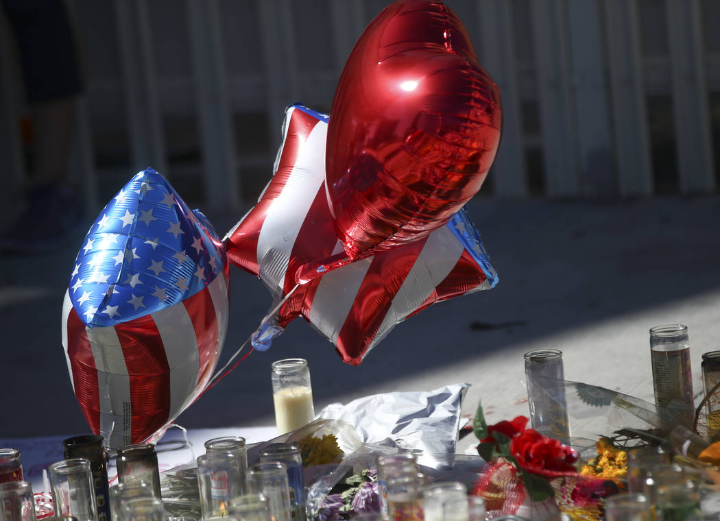 Balloons at a memorial at Las Vegas Boulevard and Sahara Avenue in Las Vegas during the early hours of Tuesday, Oct. 3, 2017. A gunman opened fire on attendees of a music festival Sunday night, re ...
