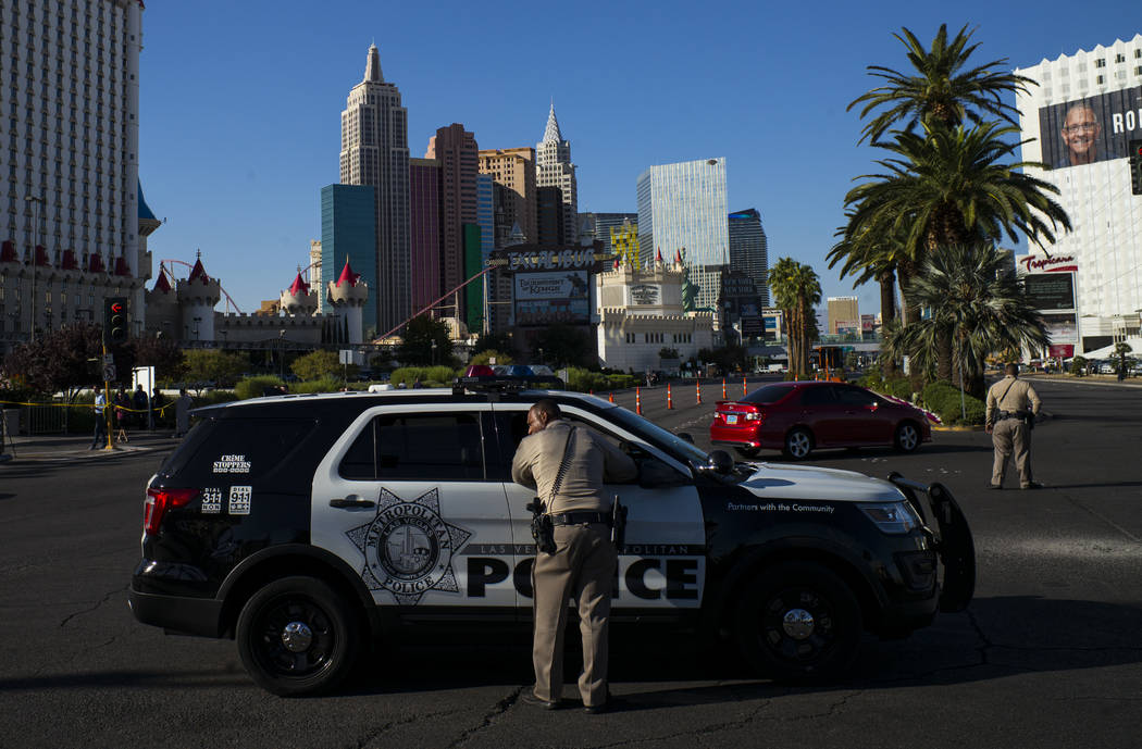 Las Vegas police officers talk at Las Vegas Boulevard and Reno Avenue outside of the Luxor, near the Route 91 music festival grounds in Las Vegas on Tuesday, Oct. 3, 2017. A gunman opened fire on  ...