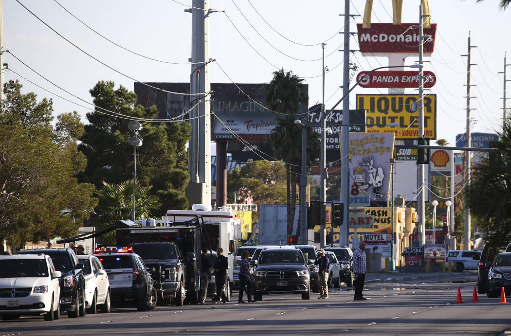 Law enforcement officers near the Route 91 music festival grounds along Las Vegas Boulevard near Reno Avenue in Las Vegas on Tuesday, Oct. 3, 2017. A gunman opened fire on attendees of a music fes ...