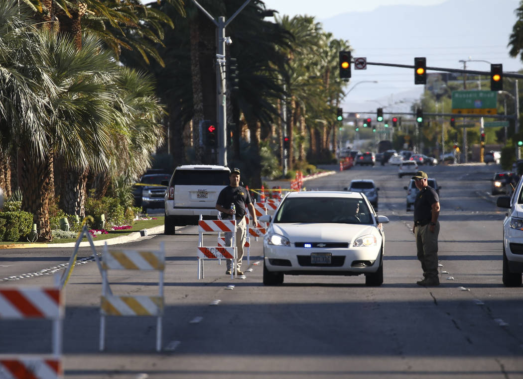 FBI officers near the Route 91 music festival grounds along Las Vegas Boulevard near Reno Avenue in Las Vegas on Tuesday, Oct. 3, 2017. A gunman opened fire on attendees of a music festival Sunday ...