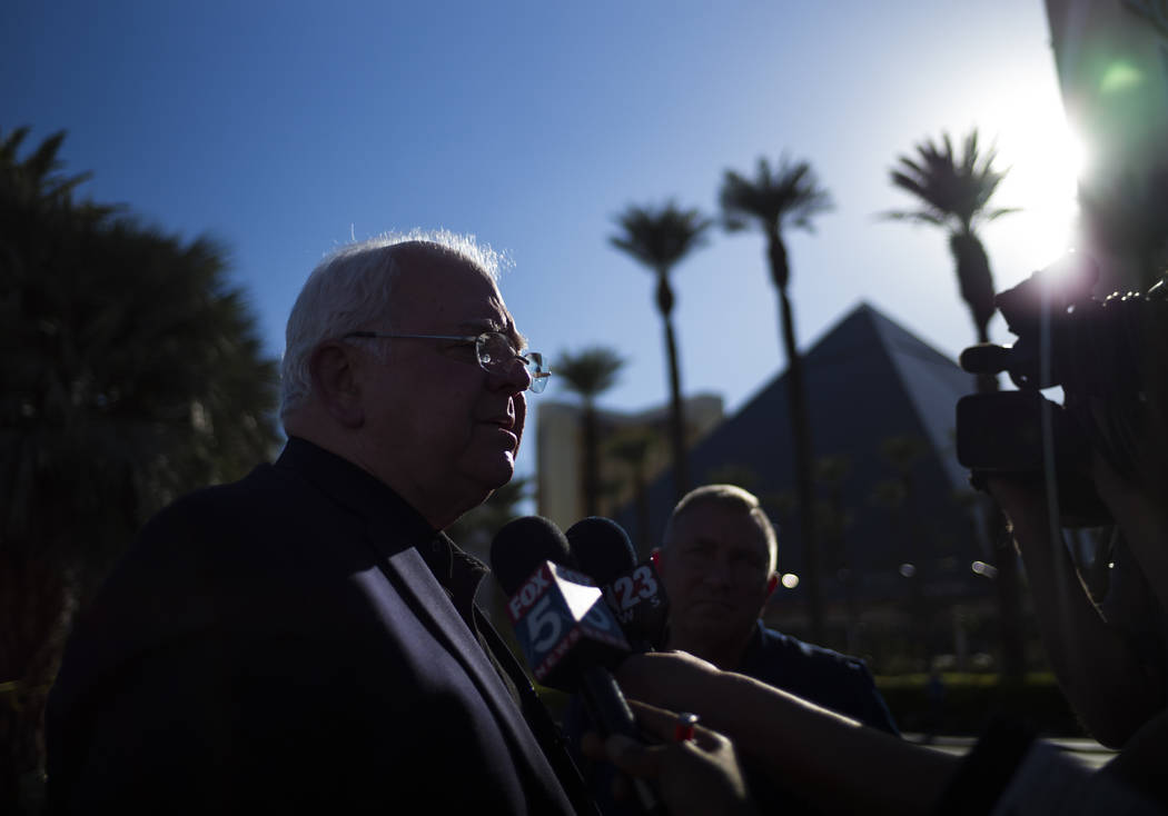 United States Conference of Mayors CEO and Executive Director Tom Cochran speaks after leaving roses by a memorial at Las Vegas Boulevard and Reno Avenue outside of the Luxor, near the Route 91 mu ...