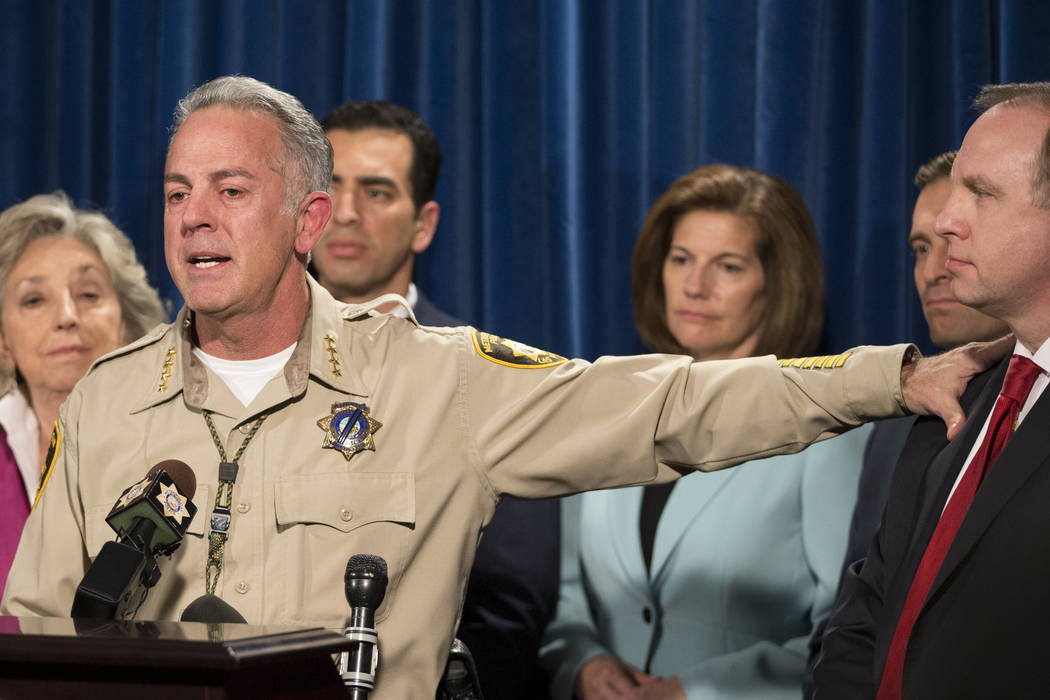 Clark County Sheriff Joe Lombardo, left, recognizes  Aaron C. Rouse, special agent in charge for the FBI in Nevada, during a press conference on the mass shooting at the Las Vegas Metropolitan Pol ...