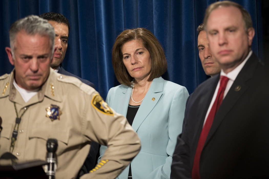 Clark County Sheriff Joe Lombardo, from left, U.S. Rep. Ruben Kihuen, D-Nev., Sen. Catherine Cortez Masto, D-Nev., Nevada Attorney General Adam Laxalt, and Aaron C. Rouse, special agent in charge  ...