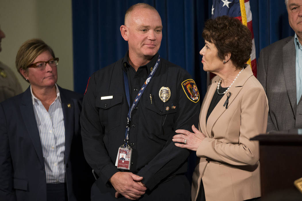 Clark County Fire Chief Greg Cassell, left, and U.S. Rep. Jacky Rosen, D-Nev., during a press conference on the mass shooting at the Las Vegas Metropolitan Police Department headquarters in Las Ve ...