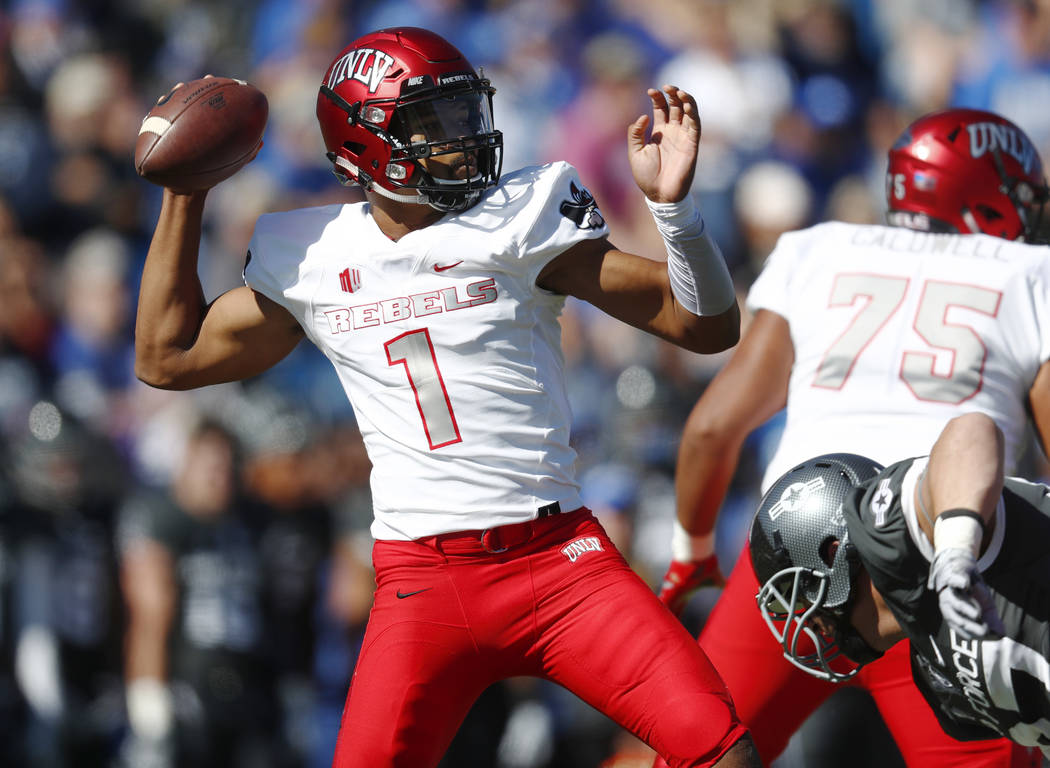 UNLV quarterback Armani Rogers, left, throws a pass over Air Force defensive lineman Santo Coppola during the first half of an NCAA college football game Saturday, Oct. 14, 2017, at Air Force Acad ...