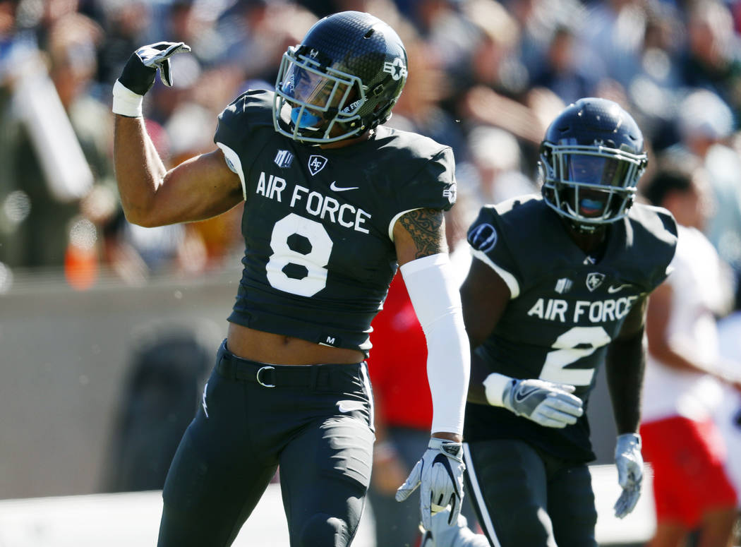 Air Force linebacker Lakota Wills celebrates after intercepting a pass thrown by UNLV quarterback Armani Rogers in the first half of an NCAA college football game Saturday, Oct. 14, 2017, at Air F ...