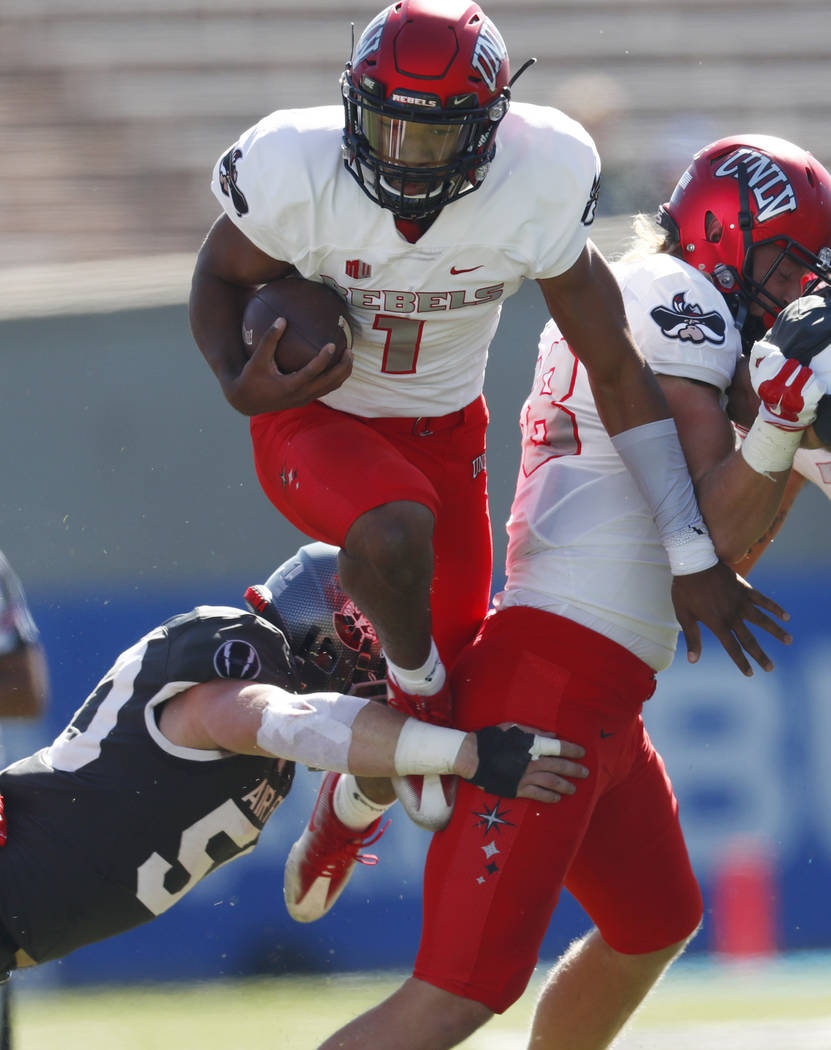 UNLV quarterback Armani Rogers, top, is tripped up by Air Force linebacker Jack Flor for a short gain in the first half of an NCAA college football game, Saturday, Oct. 14, 2017, at Air Force Acad ...