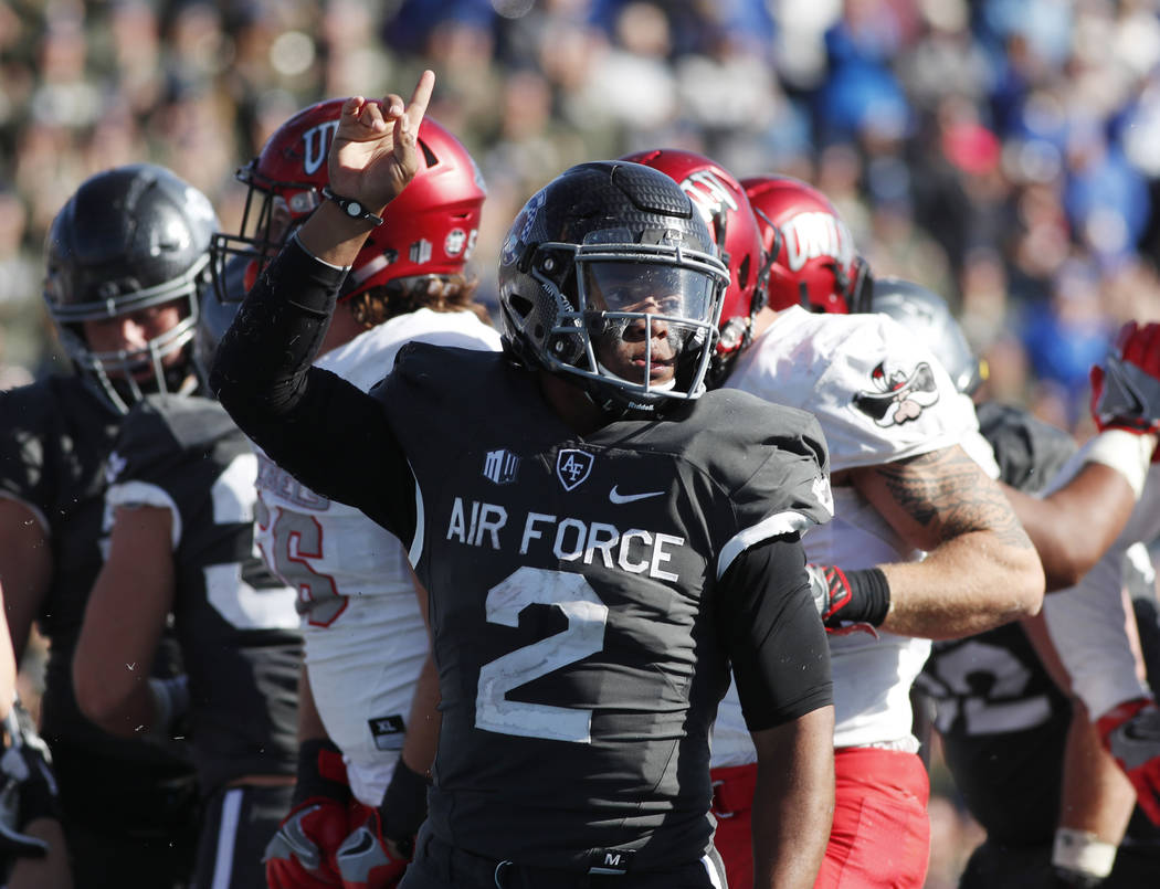 Air Force quarterback Arion Worthman, front, celebrates after rushing for the go-ahead touchdown against UNLV Rebels late in the second half of an NCAA college football game, Saturday, Oct. 14, 20 ...