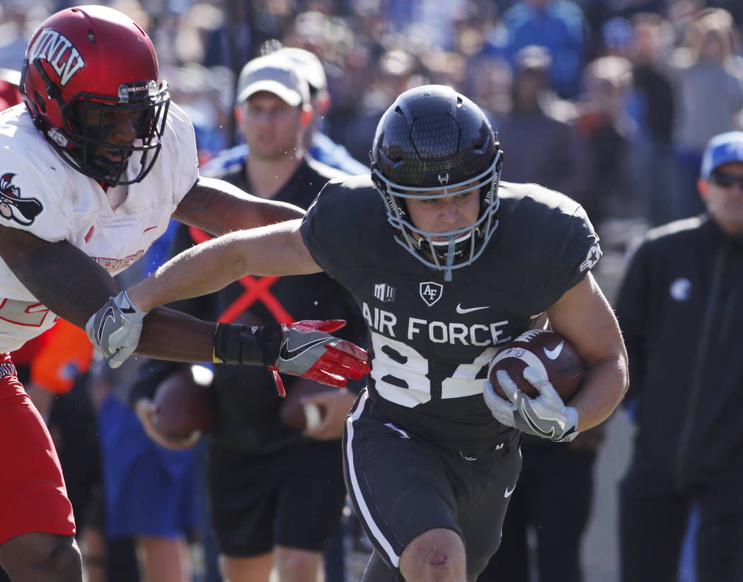 UNLV defensive back Chauncey Scissum, left, pushes Air Force wide receiver Garrett Amy out of bounds after a short gain in the second half of an NCAA college football game, Saturday, Oct. 14, 2017 ...