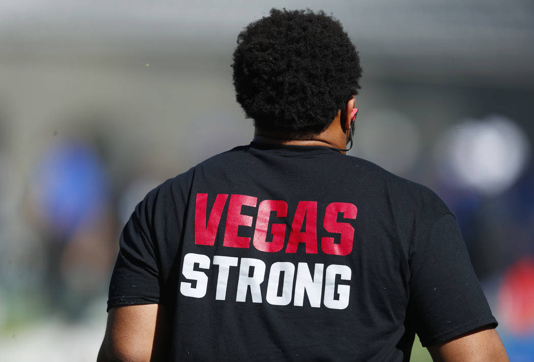 UNLV defensive lineman Mike Hughes Jr. wears a shirt with a message of support for the victims of the massacre in Las Vegas as he warms up before an NCAA college football game against Air Force, S ...