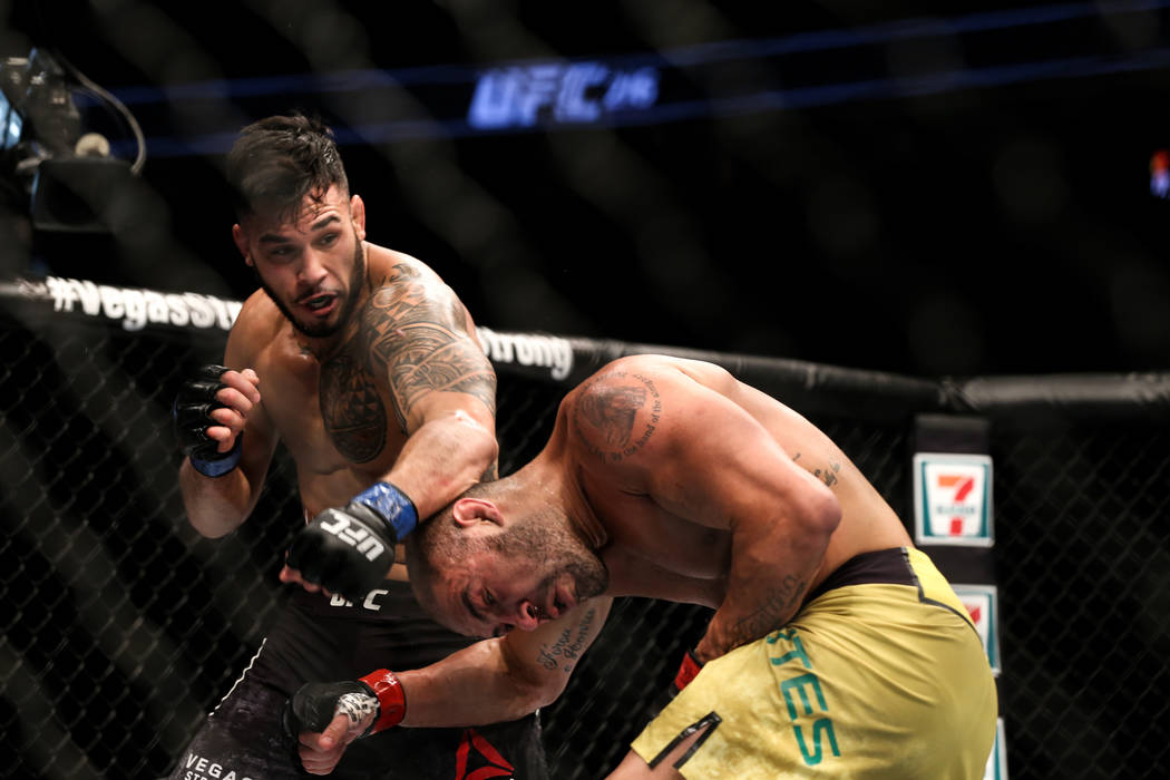 Brad Tavares, left, punches Thales Leites, right, during the second round of the preliminary middleweight bout of UFC 216 at T-Mobile Arena in Las Vegas, Saturday, Oct. 7, 2017. Joel Angel Juarez  ...