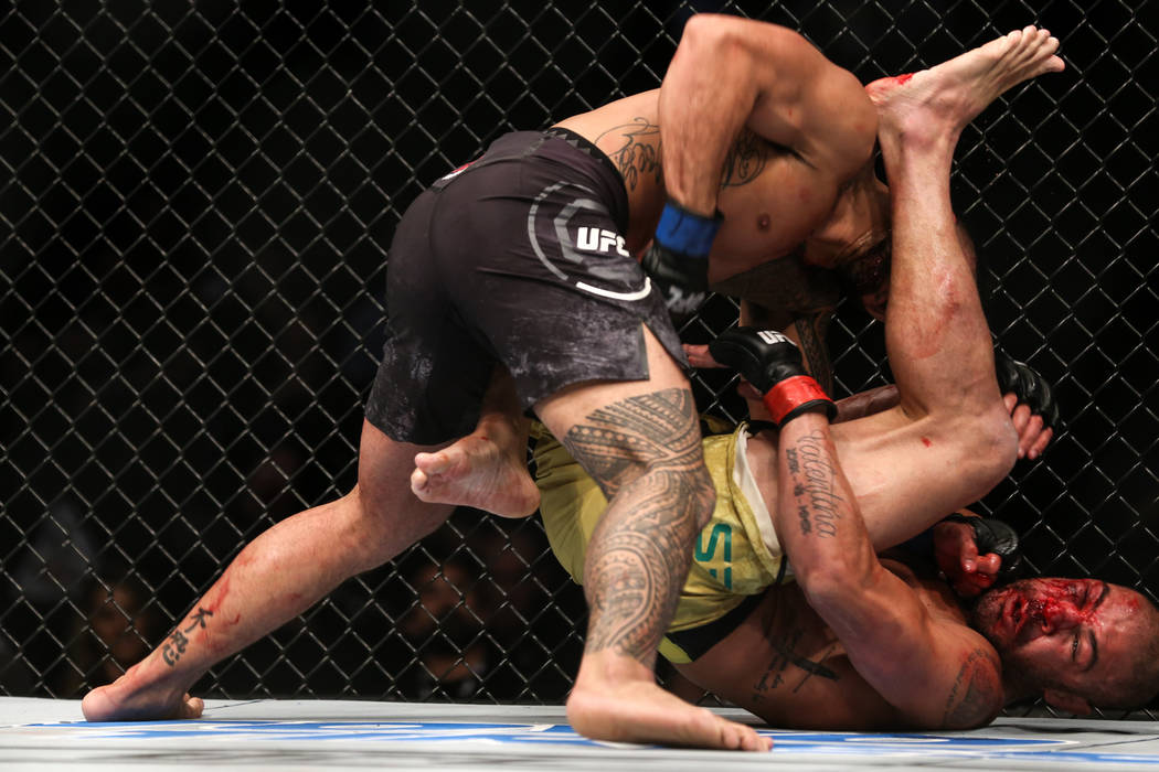 Brad Tavares, left, punches Thales Leites, right, during the third round of the preliminary middleweight bout of UFC 216 at T-Mobile Arena in Las Vegas, Saturday, Oct. 7, 2017. Joel Angel Juarez L ...