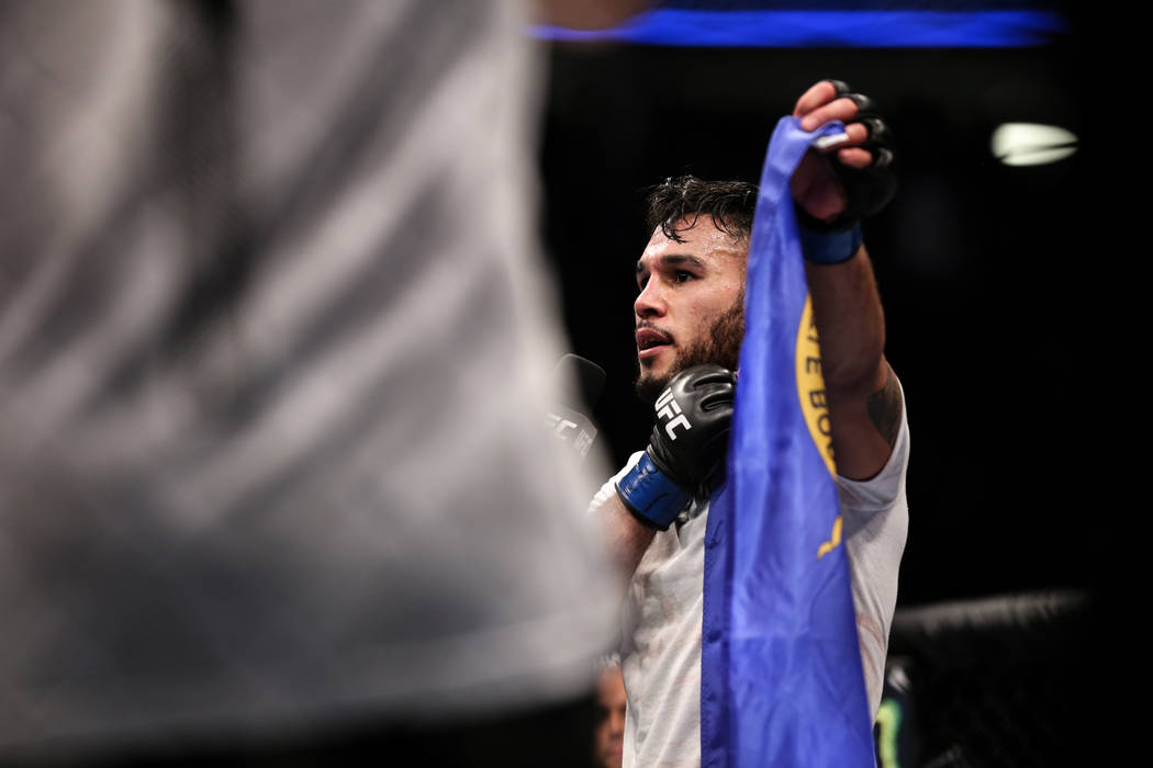 Brad Tavares holds the Nevada state flag walks after defeating Thales Leites during the preliminary middleweight bout of UFC 216 at T-Mobile Arena in Las Vegas, Saturday, Oct. 7, 2017. Joel Angel  ...