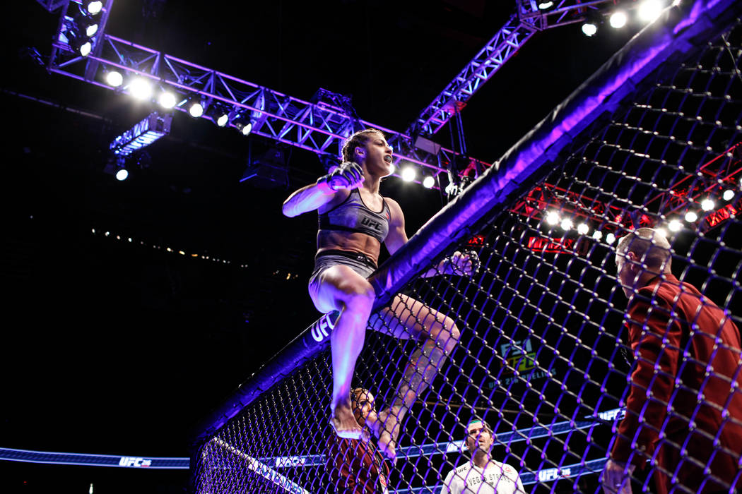 Poliana Botelho celebrates after defeating Pearl Gonzalez in the preliminary womenճ strawweight bout of UFC 216 at T-Mobile Arena in Las Vegas, Saturday, Oct. 7, 2017. Joel Angel Juarez Las  ...