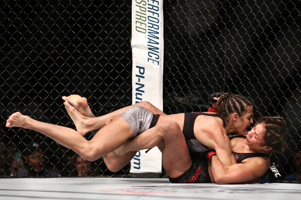 Poliana Botelho, left, takes down Pearl Gonzalez, right, during the third round of the preliminary womenճ strawweight bout of UFC 216 at T-Mobile Arena in Las Vegas, Saturday, Oct. 7, 2017.  ...