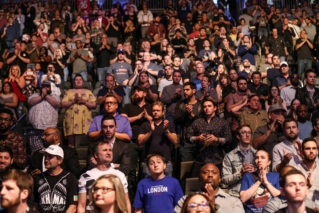 People applause as they honor victims of Sunday night's mass shooting during a ceremony at UFC 216 at T-Mobile Arena in Las Vegas, Saturday, Oct. 7, 2017. Joel Angel Juarez Las Vegas Review-Journa ...