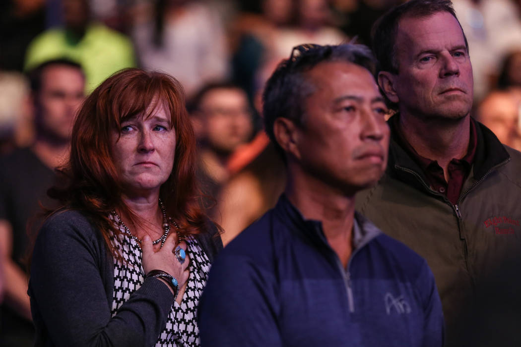 A woman places her hand over her heart during a ceremony honoring the victims of Sunday night's shooting at UFC 216 at T-Mobile Arena in Las Vegas, Saturday, Oct. 7, 2017. Joel Angel Juarez Las Ve ...