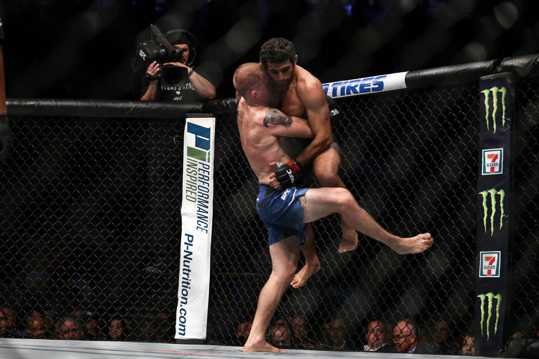 Evan Dunham, left, lifts Beneil Dariush, right, during the lightweight bout UFC 216 at T-Mobile Arena in Las Vegas, Saturday, Oct. 7, 2017. The fight was ruled a draw. Joel Angel Juarez Las Vegas  ...