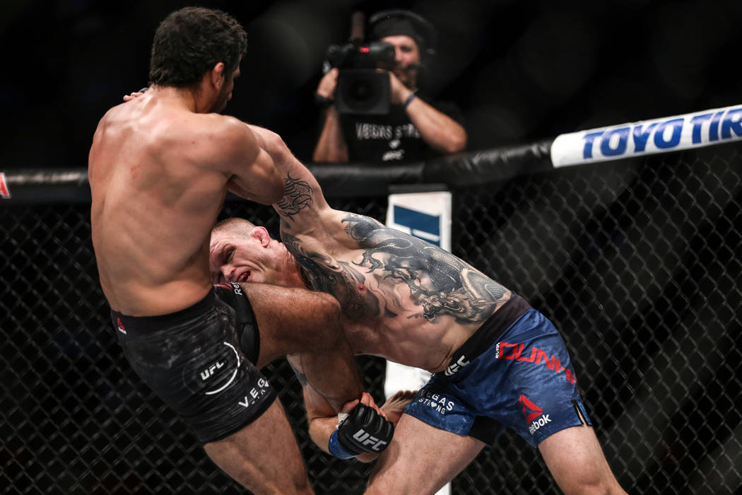 Beneil Dariush, left, is punched by Evan Dunham, right, during final round of the lightweight bout UFC 216 at T-Mobile Arena in Las Vegas, Saturday, Oct. 7, 2017. The fight was ruled a draw. Joel  ...