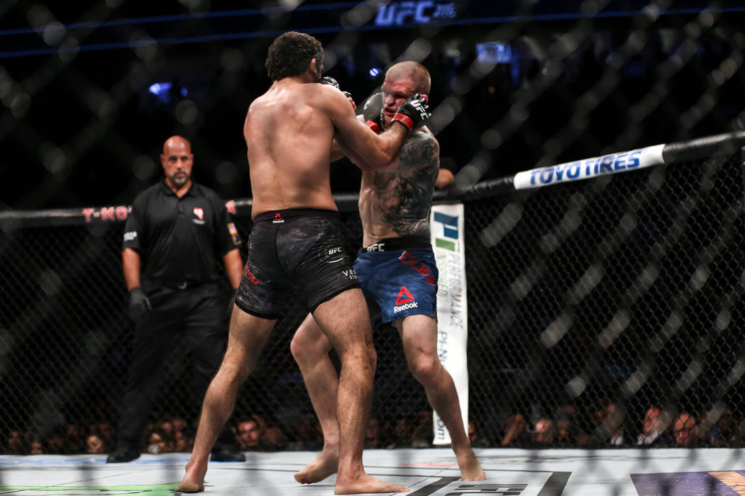 Beneil Dariush, left, and Evan Dunham, right, fight during final round of the lightweight bout UFC 216 at T-Mobile Arena in Las Vegas, Saturday, Oct. 7, 2017. The fight was ruled a draw. Joel Ange ...
