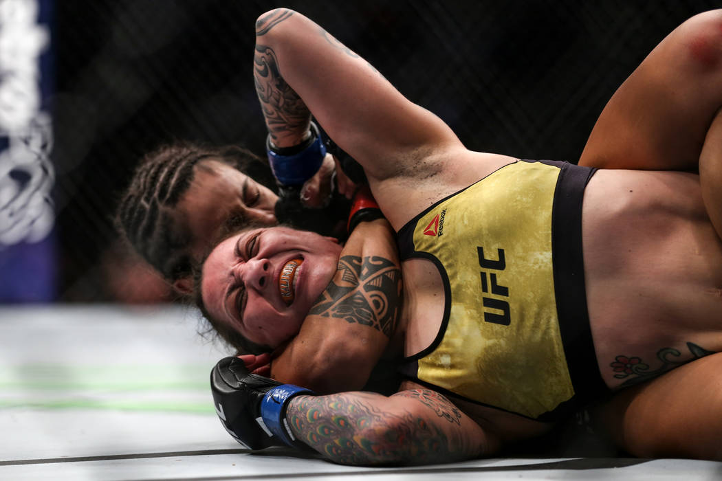 Kalindra Faria, front, is put in a submission hold by Mara Romero Borella, behind, during the flyweight bout UFC 216 at T-Mobile Arena in Las Vegas, Saturday, Oct. 7, 2017. Borella won by submissi ...