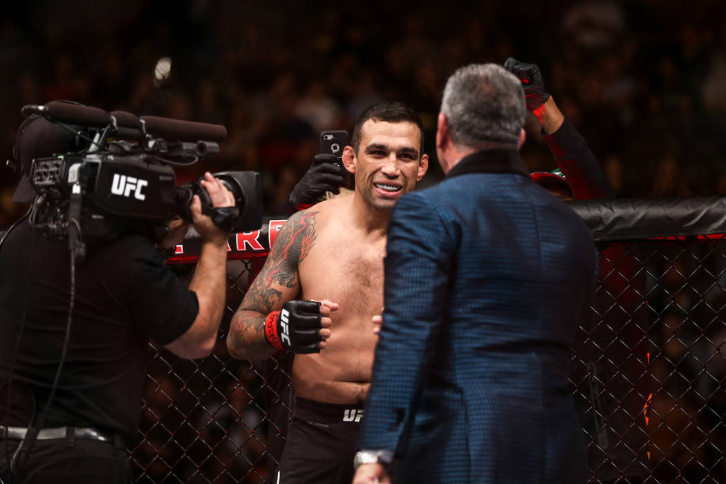 Fabricio Werdum appears in the octagon before a fight against Walt Harris during the flyweight bout UFC 216 at T-Mobile Arena in Las Vegas, Saturday, Oct. 7, 2017. Werdum won by submission in the  ...