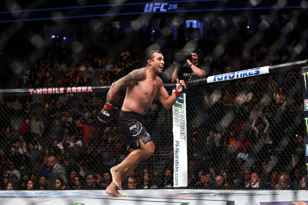 Fabricio Werdum celebrates after defeating Walt Harris in a first round submission during the flyweight bout UFC 216 at T-Mobile Arena in Las Vegas, Saturday, Oct. 7, 2017. Joel Angel Juarez Las V ...
