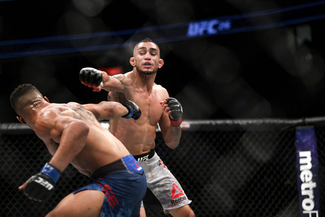 Kevin Lee, left, gets punched by Tony Ferguson, right, during the interim lightweight championship bout UFC 216 at T-Mobile Arena in Las Vegas, Saturday, Oct. 7, 2017. Ferguson won by submission.  ...